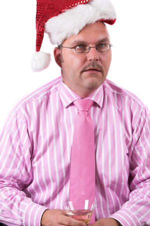 Businessman at a christmas party looking like he has totally lost it photo