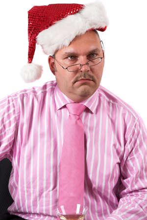 Businessman at a christmas party looking totally flabbergasted photo
