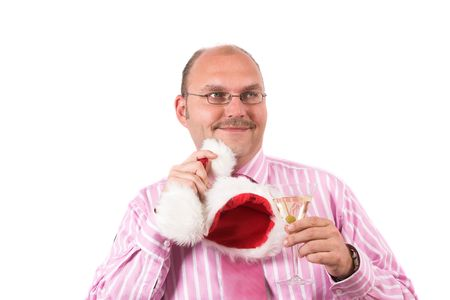 Businessman at a christmas party wiping his chin with a christmas hat photo