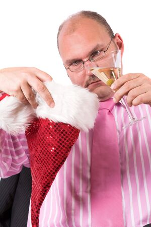 Businessman trying to pour his drink into a christmas party hat photo