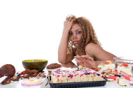 unhealthy lifestyle: Pretty black girl having just been on a food binge