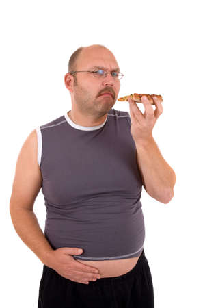 Overweight man holding his hand to his beer belly having eating too much pizza photo