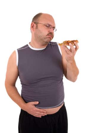 gula: Insalubres grasa hombre tratando de comer una pizza parte m�s  Foto de archivo