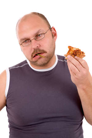 overeating: Mature man eating a pizza and having had enough Stock Photo