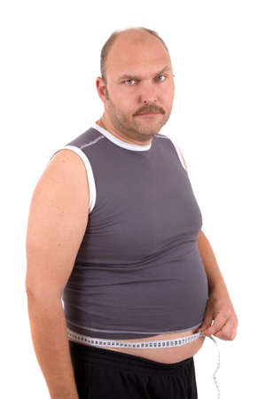 unsatisfied: Overweight man looking very unhappy with the measurement of his waist