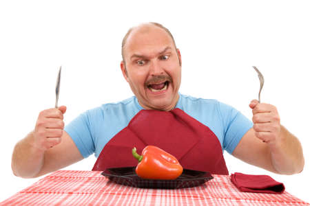 Unhappy dieting man with only a red pepper on his plate photo