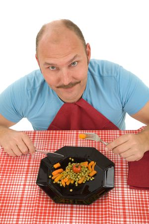 obsessed: Happy mature man on a diet eating his vegetables