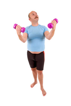 Overweight man in too tight shirt using dumbbels photo