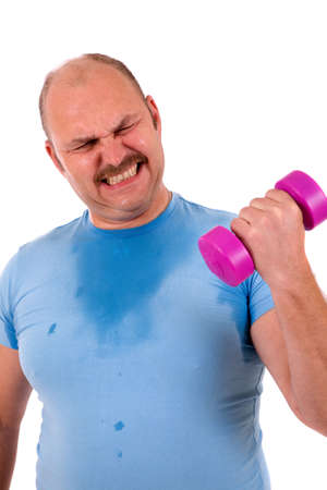 clearly: Overweight man clearly in trouble lifting a small dumbbel
