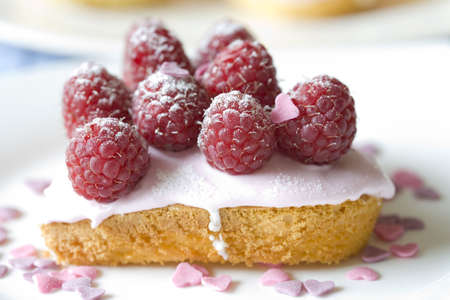 Delicious small cupcake in heartshape decorated with raspberries Stock Photo - 1848993