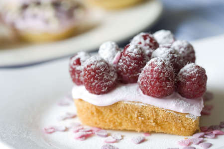 wedding food: Delicious small cake decorated with raspberries and sugar