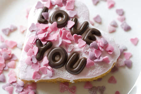 Small cake made with chocolate letters saying Love You Stock Photo