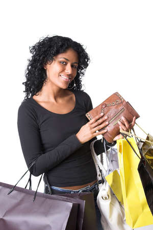 beautiful brazilian girl with her wallet in her hand and plenty of shopping bags Stock Photo - 2024107
