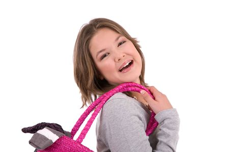 purchased: Cute teenage girl with shopping bag over her shoulder