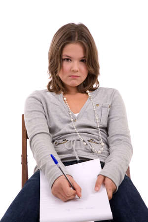 demotivated: Young teenage schoolgirl sitting in a demotivated way Stock Photo
