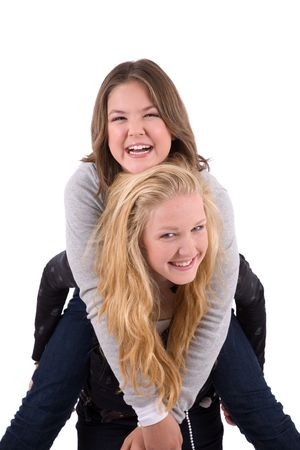 piggyback ride: Two teenage girls doing a piggy back ride