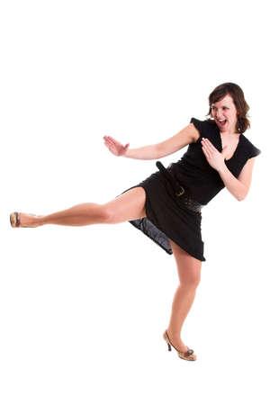little black dress: Pretty brunette in little black dress kicking in high heels
