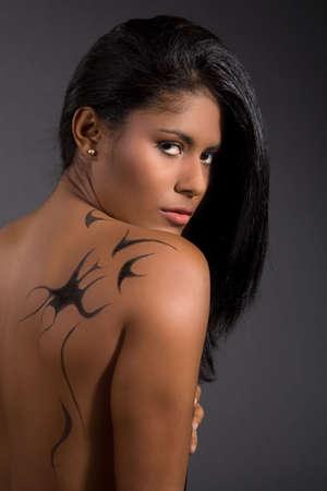 brazilian woman: Beautiful south american beauty with tattoo on her back