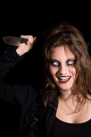 insane insanity: Dangerous looking woman with scary eyes and a knife in her hand