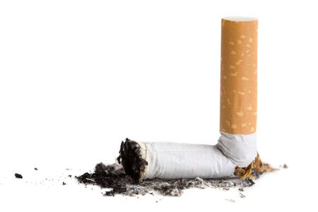 burned out: Burned out cigarette stub on white background Stock Photo