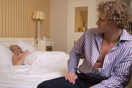 Couple having had an argument in the bedroom photo