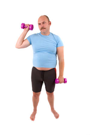 demotivated: Demotivated sports man with dumbbells and a too tight shirt
