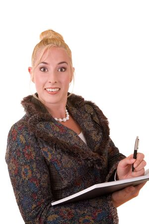 Blond woman in professional outfit with pen in her hand on white background photo