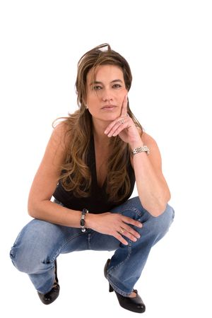 Beautiful mature woman in casual clothing kneeling photo