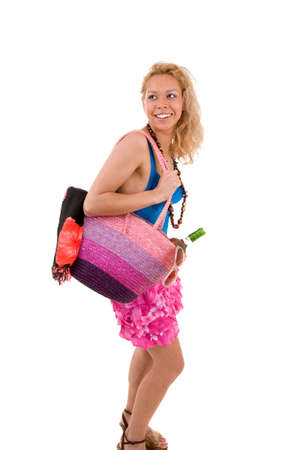 beachbag: Happy blond girl going to the beach with her bag