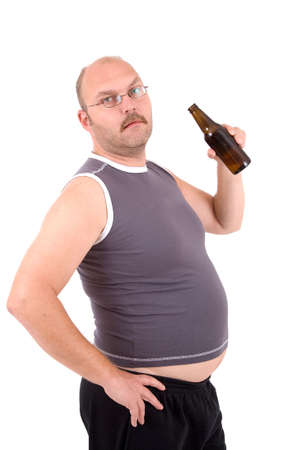 potbelly: Overweight man holding a beerbelly and sticking out his beer belly Stock Photo