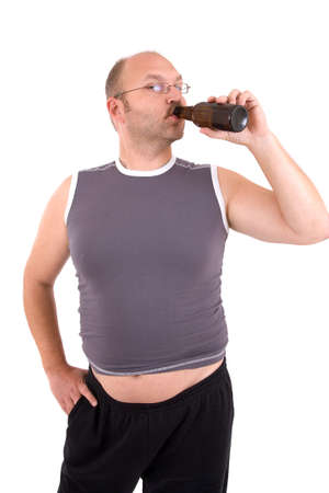 Overweight man with beerbelly having a sip from his beer photo