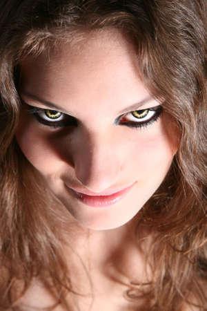 ferocious: Dangerous looking woman with fierce yellow eyes Stock Photo