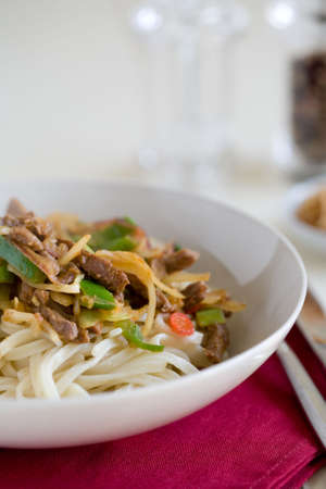 deliciously: Deliciously prepared noodle dish with beef and vegetables Stock Photo