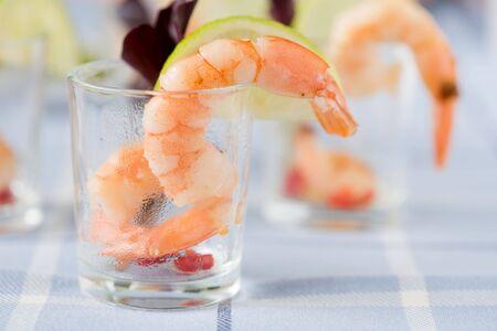 crudite: Delicious shrimp in small cocktailglass with lemon Stock Photo