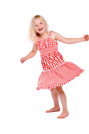 Cute four year old girl dancing around happily Stock Photo