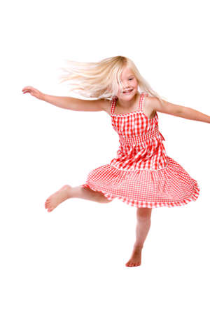 Adorable four year old girl dancing around on white background