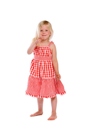 ragazza che indica: Piccolo grazioso quattro anni la sua ragazza che punta il dito