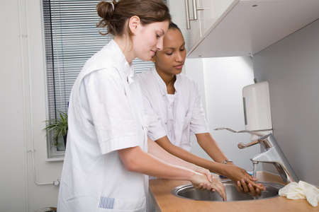 Two medical students washing their hands thoroughly