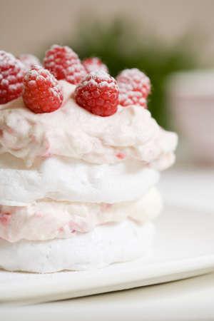 Sweet meringue delicious dessert with raspberry cream photo