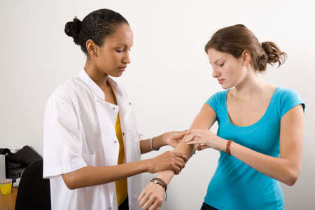 hurting: Patient explaining to the doctor where it is hurting Stock Photo
