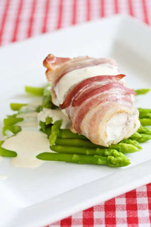 delicious angler fish wrapped in pancetta with fresh asparagus