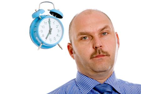 Businessman looking slightly annoyed with a clock next to his head photo