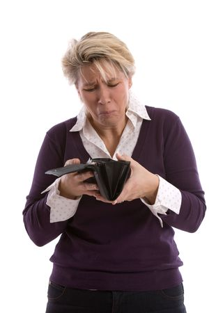 troublesome: Mature woman looking into her wallet with a troublesome look