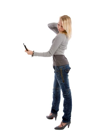 Pretty blond teenager posing for her own phone camera photo