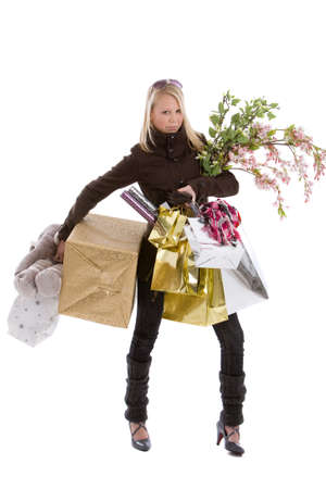 Teenage girl loaded with various bags doing christmas shopping on white background photo