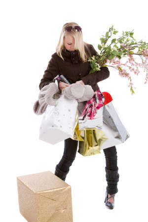 Pretty teenage girl trying to carry too many bags Stock Photo