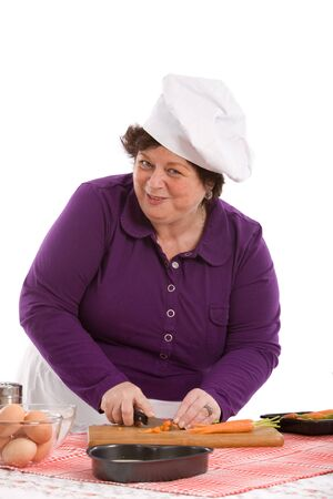 Female chef preparing the carrots in the kitchen Stock Photo - 4036450