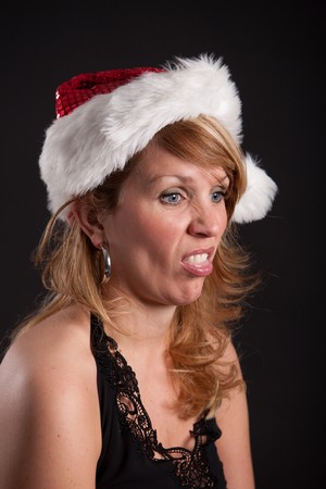Attractive young woman sticking out her tongue while pulling a face photo