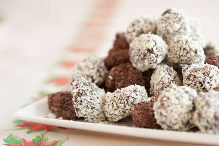 chocolaty: Delicious home made chocolate truffels with white and dark chocolate flakes Stock Photo