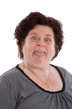 Mature woman in her fifties pulling a funny face on white background photo